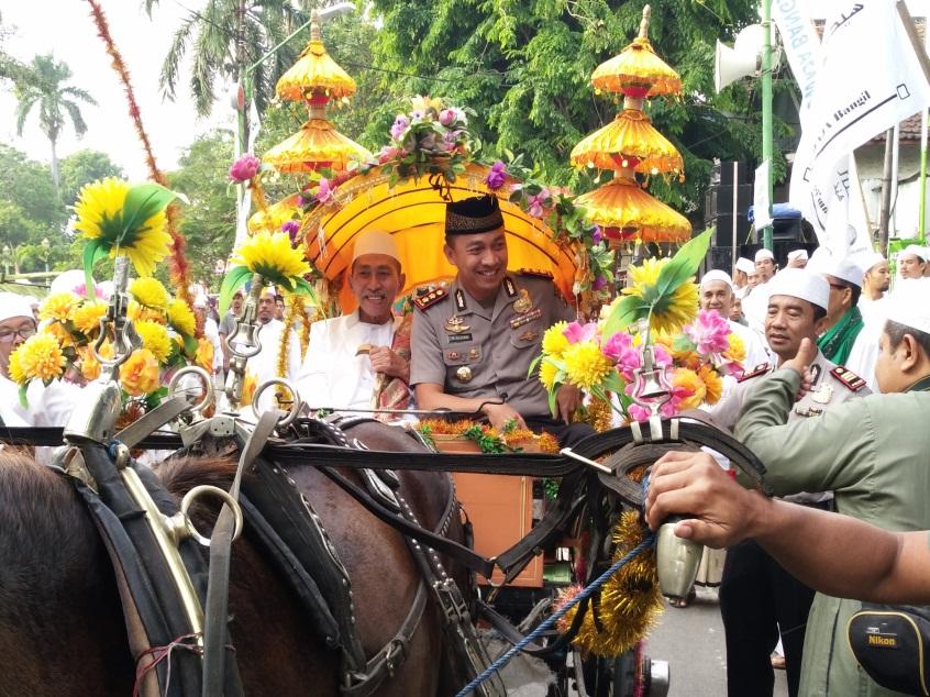 Anggota Polres Pasuruan Lakukan Giat Pengamanan Pawai Ta Aruf 1