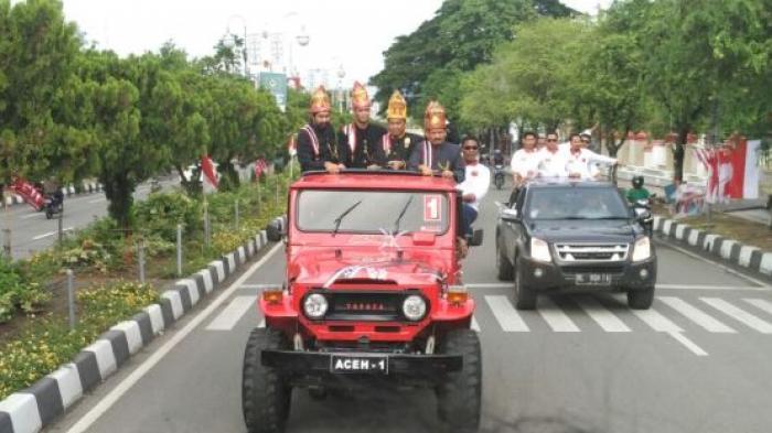 Mobil Berbendera Partai Aceh Sesaki Jalan Mohd Jam Diponegoro Taman