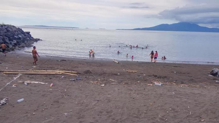 Jadi Lokasi Liburan Keluarga Pantai Malalayang Manado Minim Fasilitas Kota